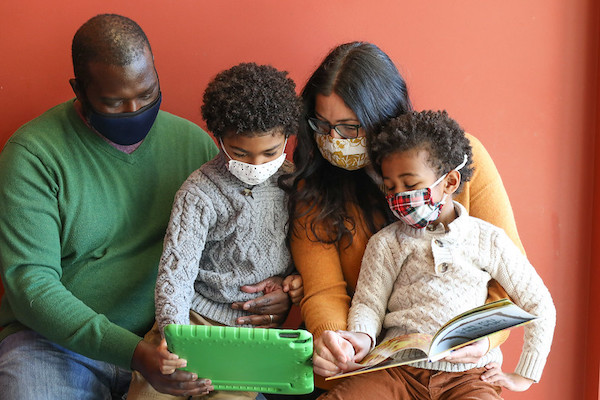 Black family reading together